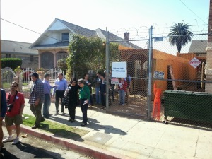 People lining up to board for a bus tour of the historic Jewish Boyle Heights